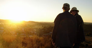 Two Men Watching Sunset. Over small South African town royalty free stock photos