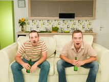 Two men watching tv Royalty Free Stock Image