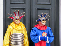 Two men wearing carnival masks in Venice Stock Photography