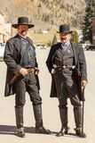 Two men wearing moustaches and vintage Old West Sheriff outfits stock images