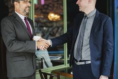 Two Men Wearing Suit Jackets Doing Hand Shake royalty free stock photo