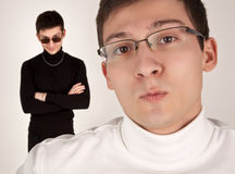 Two men in white and black clothing Royalty Free Stock Photo