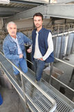 Two men in wine factory Stock Photography