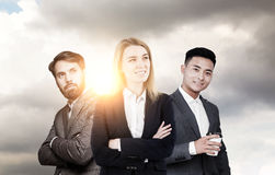 Two men and a woman against rising sun Royalty Free Stock Photography