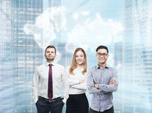 Two men and woman in a city Stock Images