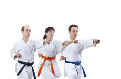 Two men and a woman are hitting a punch arm royalty free stock photos