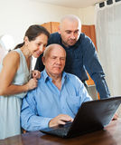 Two men and woman at home online Royalty Free Stock Photo