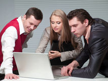 Two men and woman working Royalty Free Stock Image