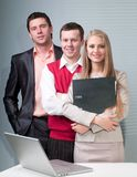 Two men and woman working with a computer Royalty Free Stock Images