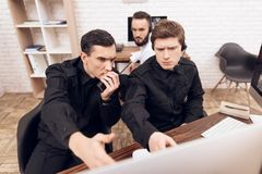 Two men work as guards. royalty free stock photo