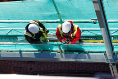Two men working on construction site Stock Image