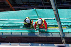 Two men working on construction site Royalty Free Stock Photo