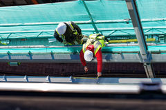 Two men working on construction site Royalty Free Stock Image