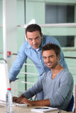 Two men working Royalty Free Stock Photography