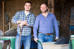 Two men working on a farm Royalty Free Stock Photo