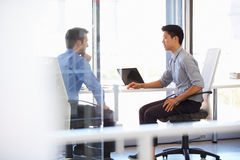 Two men working in a modern office Royalty Free Stock Photography
