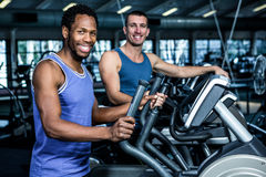 Two men working out together. At the gym Stock Photography