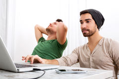 Two men working in their home office Royalty Free Stock Image