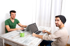 Two men working in their home office Royalty Free Stock Photo