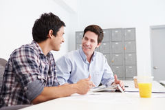 Two Men Working Together In Design Studio Stock Photography