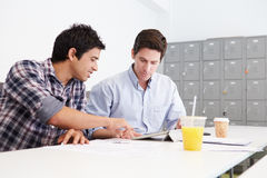 Two Men Working Together In Design Studio Stock Photo
