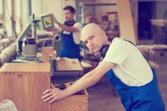 Two worker in a carpenter`s workshop Royalty Free Stock Photography