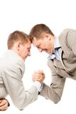 Two men wrestling with arms Stock Photography