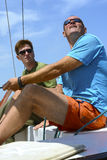 Two men on yacht Royalty Free Stock Image