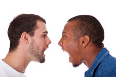 Two men yelling at each other. Two young men yelling at each other. All on white background Royalty Free Stock Images