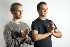 Two Men in a Yoga Pose - Horizontal Stock Photo