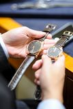 Two mens mechanical watch Stock Photos