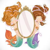 Two mermaidholding a big mirror Royalty Free Stock Photo