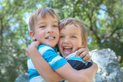 Two Merry Brothers Hugging Stock Photography