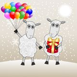 Two merry sheep with a gift and marbles Stock Photos