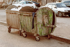 Two messy trash dumpsters painted in green color Royalty Free Stock Images