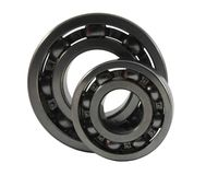 Two metal ball bearings. Two metal ball bearing on the white background Royalty Free Stock Images