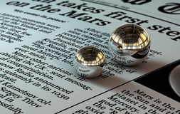 Two metal balls. On the newspaper with reflection stock illustration