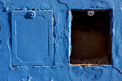 two metal box and a blue wa Royalty Free Stock Image