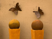Two metal butterflies on the wall Stock Photos