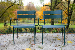 Two metal chairs in the park Stock Photos