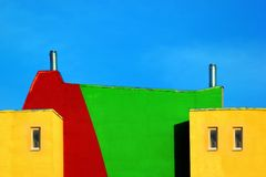 Two metal chimneys on a roof of a house. Against blue sky background stock photo