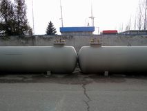 Two metal cisterns on the street Stock Photography