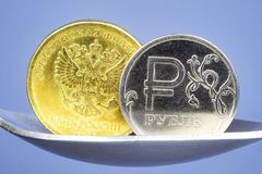 Two metal coins close-up, gold and silver ruble. Coin stock photo