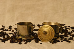 Two metal cups. With coffee in detail royalty free stock photos