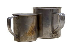 Two metal dirty mugs Stock Images
