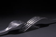 Two Metal Forks Entwined Stock Images