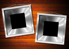 Two Metal Frame on a Old Wood Wall Stock Image
