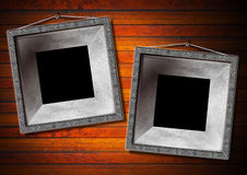 Two Metal Frame on a Old Wood Wall Royalty Free Stock Photos