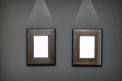 Two metal frame on the wall with lighting Royalty Free Stock Photos