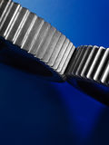 Two Metal gears on dark blue background. Royalty Free Stock Photography